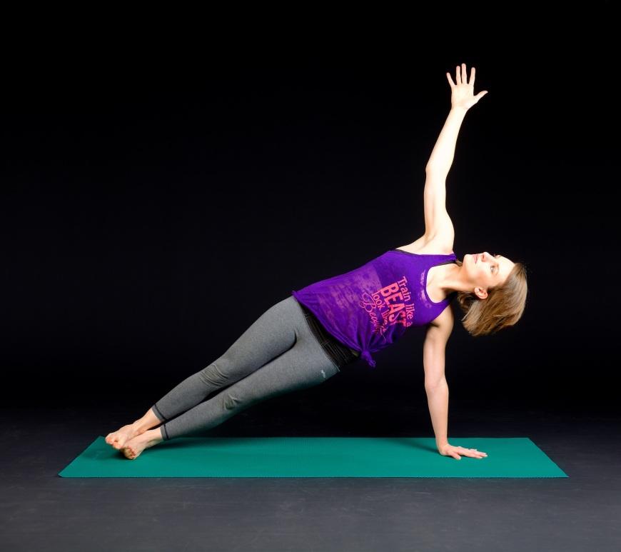 women doing side plank